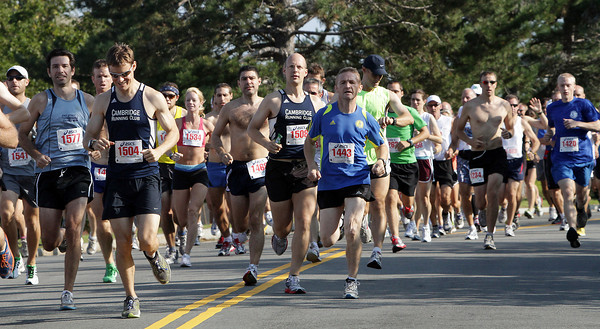 A very large field of runners in the Around Cape Ann 25K road race depart from O'Maley Middle School on Monday morning. David Le/Gloucester Daily Times.