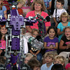 "Rockport Elementary students Faith Roberts, right, and Abigail Mellen, second from right, clap as a ""space robot"" performs tricks for the students on Wednesday afternoon. David Le/Gloucester Daily Times"