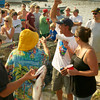 Gloucester:  Scott Willson of Team Alves, pumps his fist to the large crowd, just before receiving the $1500.00 dollar first place prize money at the BlueFish Tournament at Lanes Cove Sunday afternoon.   Desi Smith/Gloucester Daily Times. September 5, 2011