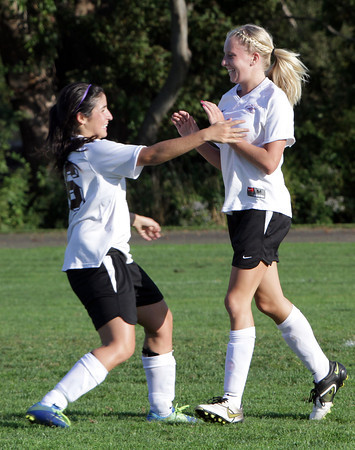 Rockport's Eva Weinstein, left, happily greets teammate Rachel Davis, right, after she scored Rockport's goal in the first half of play against North Shore.  David Le/Gloucester Daily Times