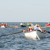 Gloucester: Rowers heads towards the breakwater to make their first turn at the orange ball far left in the Gloucester Maritime Heritage Gig Rowers Race that started at Niles Beach Saturday morning.  Desi Smith/Gloucester Daily Times. September 10, 2011