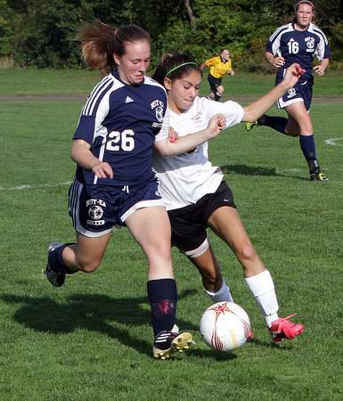 Rocport's Shelby Salas, right, battles for possession of the ball with North Shore Tech's Makayla Norden during their game on Monday afternoon. David Le/Gloucester Daily Times