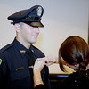 Gloucester: New police officer Anthony Giacalone Jr has his badge put on him by his wife, after being  sworn in by Mayor Kirk, last night at City Hall. Desi Smith/Gloucester Daily Times. September 22, 2011