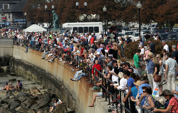 The Boardwalk was packed with spectators for the Parade of Sail on Sunday morning as schooners paraded by the onlookers, then headed out near the Eastern Point Lighthouse to pay tribute to Joseph Garland with canon fire. David Le/Gloucester Daily Times