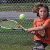 Rhodes Cole, 9, visiting his grandmother from California, plays tennis at Stage Fort Park on Monday afternoon. David Le/Gloucester Daily Times