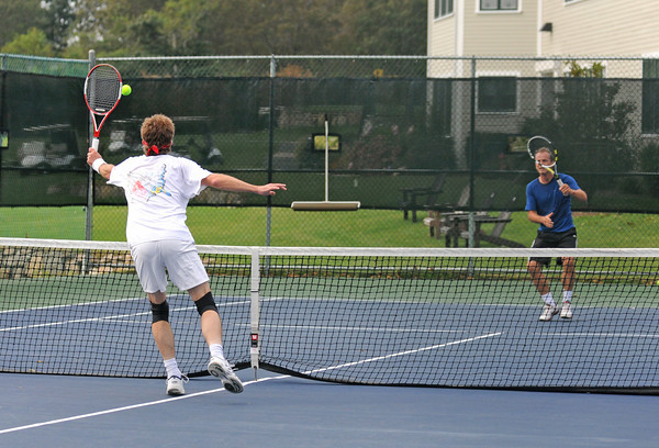 Gloucester: Chris Holmes returns a volley against Martin Hertli in a singles match Saturday morning at Bass Rocks Open Tennis Tourney.  Desi Smith /Gloucester Daily Times. September 3,2011