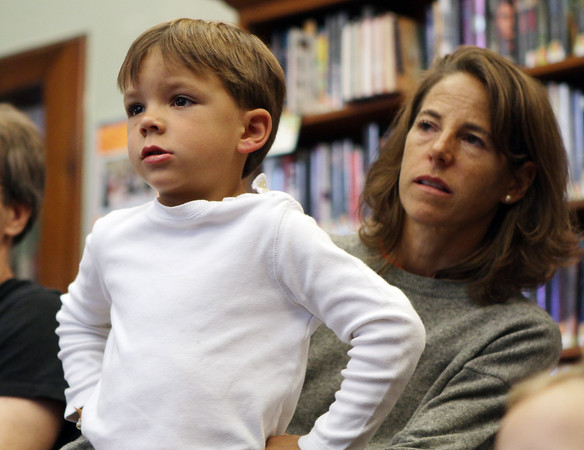 Deuce Morton, 5, of Manchester, sits on his mother Cindy's lap as they watch a Sea Story Puppets show about pirates at Manchester  Public Library on Monday. David Le/Gloucester Daily Times