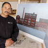 Local contractor Tony Giacalone stands next to a few of his final elevation plans for the Old Paint Factory from back in 2002. Giacalone tried for 5 years to renovate the Old Paint Factory and create a one-family mansion, but was met by strong opposition and eventually was forced to let go of his project. David Le/Gloucester Daily Times