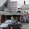 Customers visiting Woodman's on Monday afternoon lined up down the Main St. sidewalk while waiting to go inside and order their food. David Le/Gloucester Daily Times.