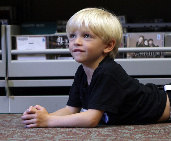 Sammy Bothwell, 4, of Manchester, lies on the floor during a storyhour at Manchester Public Library. David Le/Gloucester Daily Times