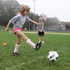 Rockport 3rd grader Jane Ryan, left, takes a shot on net after receiving a pass from Carling Berglund, right at RYSA practice. David Le/Gloucester Daily Times