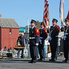 Rockport: Rockport Color Guards stand at attention as Firefighter Jack Hennessey rings the bell remembering those who lost their lives 10 years ago on 9/11 in New York. Police, Fire and locals took part in a ceremony held on T-Wharf Sunday morning. Desi Smith/Gloucester Daily Times. September 11, 2011