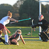 Gloucester:  Gloucester's Forward takes out a Salem defenderb as Salem's Goalkeep come's in to help,yesterday afternoon at GHS. Desi Smith/Gloucester Daily Times. September 19, 2011