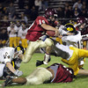 Gloucester High School senior Nick Taormina jumps over a block from one of his offensive linemen and springs the ball for a big gain against Andover on Friday night. David Le/Gloucester Daily Times