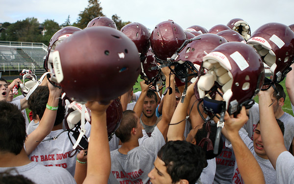 Gloucester High School football captain Kyle Lucido, center, breaks down the huddle following practice on Thursday afternoon as they prepared for their opening game against Lynn Classical on Friday evening. David Le/Gloucester Daily Times.