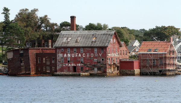 The left side of the Old Paint Factory is now falling into the water and other repairs are being done to the rest of the building. David Le/Gloucester Daily Times