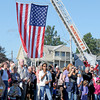Rockport: People came to T-Wharf to remember those who lost their lives 10 years ago on 9/11 in New York. Desi Smith/Gloucester Daily Times. September 11, 2011