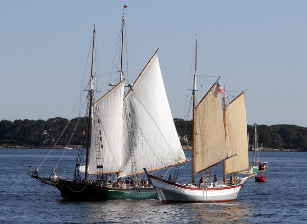 Schooners Lannan, left, and Ardelle, both of Gloucester, cross paths on late Friday afternoon in Gloucester Harbor. Both schooners will be taking part in the Parade of Sail on Sunday morning as well as the Schooner Festival all weekend long. David Le/Gloucester Daily Times