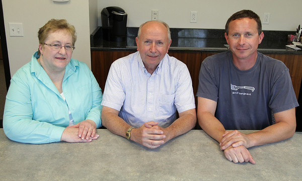Pete Spinney, center, CEO of Anchor Seal, sits with his wife Marjorie, left, and son Andrew, right, in their new office building they built in Blackburn Industrial Park after moving from Danvers. David Le/Gloucester Daily Times