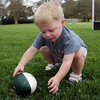 Richie Grant, 2, of Manchester, picks up his football while playing catch. David Le/Gloucester Daily Times