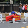 Gloucester:Jenna LeClerc 8, crosses the finish line in the Modified Divison, at the Fishbox Durby, as her friends look on, Sunday afternoon on Roger St.  Desi Smith/Gloucester Daily Times. September 18, 2011