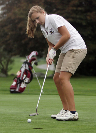 Rockport's Courtney Nelson watches the ball as it slowly rolls towards the cup on Thursday afternoon in their match against Manchester-Essex at Rockport Country Club. David Le/Gloucester Daily Times