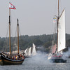 The Fame, from Salem, MA, fires its cannons and acknowledges the onlookers on the Boulevard during the Parade of Sail on Sunday morning. David Le/Gloucester Daily Times