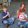 Gloucester: From left,  Jackson Pierce 5, his brother Clay 3, and sister Maia 3, got a chance to play a Skhor at the Sawyer-Free Library: Rosh Hashanah music and story hour, Thursday afternoon.  Desi Smith/Gloucester Daily Times. September 22, 2011