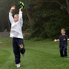 Danny Herrick, 7, of Gloucester, jumps as the football sails over his fingertips and towards the open arms of Thurston Eck, 5, right, at Evans Field in Rockport. David Le/Gloucester Daily Times