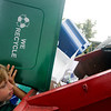 Allegra Boverman/Gloucester Daily Times. Essex Elementary School fifth grader Cam Ellis, a member of the school's Green Team, recycles paper and other items with the group a few times a week.