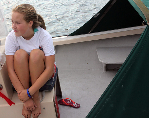ALLEGRA BOVERMAN/Gloucester Daily Times Laura Smith, 12, of Beverly, relaxes in a family friend's boat at the Manchester Town Dock on Friday afternoon.
