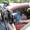 Gloucester: Bob Zalvan of Millis, Mass is congratulated by Fox News anchor Gene Lavanchy soon after winning a brand new 2013 Mazda CX-5 from Fox News Mazda Car Giveaway, during their final Zip Trip of the year to Gloucester.  14 finalist sat in the new cars next to the Band Stand at Stage Fort Park Friday morning, and when prompted to start their engines, unbelievably Bob's car started, winning his second car hosted by Fox News in the past 15 years. In 1997 he won a Ford Windstar.  Desi Smith/Gloucester Daily Times. August 312012