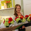 Allegra Boverman/Gloucester Daily Times Elise Jillson of West Gloucester  carries bridesmaids' bouquets for a wedding that Celia Gibson of Celia's Flower Studio was preparing on Friday at the Lanesville shop.