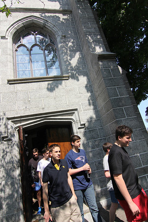 Allegra Boverman/Gloucester Daily Times. Students from St. Kevin's College in Melbourne, Australia are visiting the U.S. for a few weeks, staying in Manchester, Essex and Beverly Farms. They were touring historical sites in Manchester on Monday, including Crowell Chapel. In front, from left, with their classmates, are students Rob La Marca and Andy Clough.