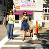 Manchester:    Britta Magnuson of Essex left and Cynthia Bauer of Beverly leave Captain Dusty's Ice Cream with their just desserts Monday afternoon. Cynthia's dog Kambe will get his licks later. Desi Smith/Gloucester Daily Times. September 2, 2012