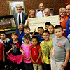 Allegra Boverman/Gloucester Daily Times The Super Snack program kicked off at Veterans Memorial Elementary School on Monday afternoon in conjunction with the Passport to Fitness Program which also kicked off at the same time. Children at the school can get a wholesome, hearty snack that could double as a meal if needed, after school from 3-3:30 p.m. Monday through Thursday. It is staffed by Open Door Food Pantry staff. They can also participate in the Passport to Fitness program which is staffed by Cape Ann YMCA staff. There will also be crafts, games and time to do work in the school's vegetable garden. Harvard Pilgrim Healthcare Foundation members were on hand to give a $10,000 check to help fund the program, which is a collaboration with the school, the city, Cape Ann YMCA, the Open Door Food Pantry, Addison Gilbert Hospital and the Food Project.