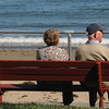 Jim Vaiknoras/Gloucester Daily Times: <br /> Linda and Martin Sykes relax on one of the benches on Front Beach in Rockport Monday. The town plans on replacing the benches, which are in varying degrees of disrepair.