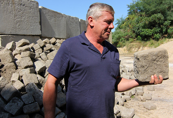 Allegra Boverman/Gloucester Daily Times. Don Peavey, the Public Works Inspector for the City of Gloucester, talks about the historic, hand-cut Gloucester granite curbing and cobblestones that they save and reuse throughout the city.