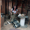 "Jim Vaiknoras/Gloucester Daily Times: <br /> Katherine Dench enjoys her lunch Wednesday in a ""Typical Fisherman shack"", an exibit at Maritime Gloucester. Deuch works at the museum."