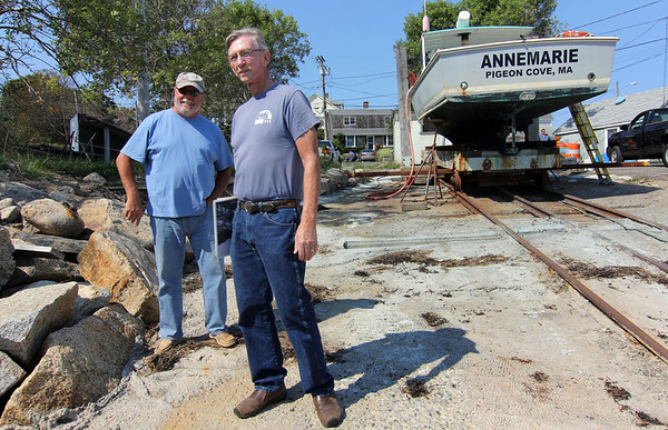 Allegra Boverman/Gloucester Daily Times. Bruce Reed and Jim Waddell of Pigeon Cove Boat Owners Association at the renovated, <br /> upgraded and open boat wash in Pigeon Cove. The most important feature is the water collection system they developed to prevent runoff from going back into the ocean water at the foot of the ramp.