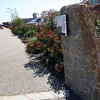 Allegra Boverman/Gloucester Daily Times. The granite markers along HarborWalk like this one are Gloucester granite and are enjoying a new life. They were previously curbs somewhere in the city.