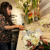 Allegra Boverman/Gloucester Daily Times Sueky Ginsburg of Beverly helps make corsages for a wedding that Celia Gibson of Celia's Flower Studio was preparing on Friday at the Lanesville shop.