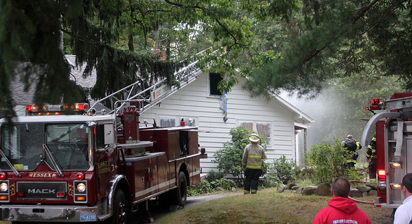 Allegra Boverman/Gloucester Daily Times.  Essex firefighters work at the scene of a fire at 153 Eastern Avenue in Essex on Friday afternoon.