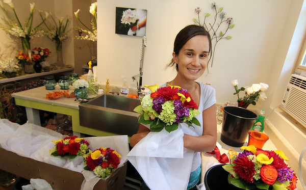 Allegra Boverman/Gloucester Daily Times Celia Gibson of Celia's Flower Studio in Lanesville was preparing for a very busy weekend of weddings on Friday afternoon. She was doing flowers for six different weddings with the help of two friends who are also her assistants.