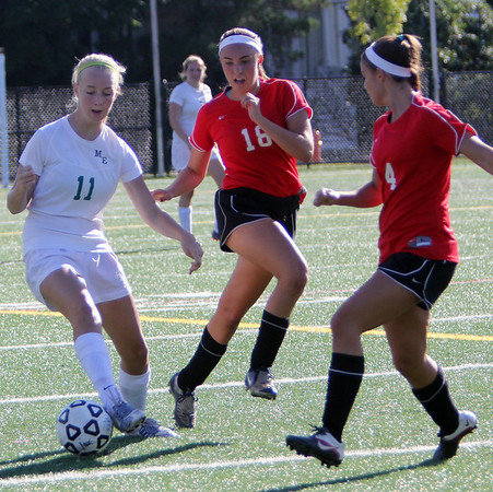 Allegra Boverman/Gloucester Daily Times Manchester-Essex player Isadora Decker-Lucke, left, in action against Marblehead's Sydney Cayen, center and Kiley Fischer, right, during their game on Tuesday afternoon in Manchester.