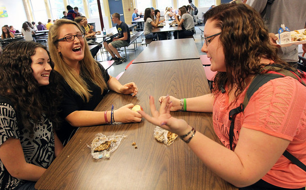 Allegra Boverman/Gloucester Daily Times Eating lunch on Monday morning at Gloucester High School are, from left, sophomores Emily Russo, Chloe Flavin and Megan Marshall. They were talking about how things are going at school now that the new year has begun.