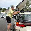 ALLEGRA BOVERMAN/Gloucester Daily Times Kathy Halmi of Lexington, 73, was loading her kayak on her car at  Essex Landing after a very strenuous kayaking jaunt on the Essex River with her daugther-in-law Paula Brown of Ipswich on Friday afternoon. Halmi was laughing because she was so tired as they reached the end of their trip that she asked someone on shore to help her get out of her kayak, and she and the man who assisted her both ended up falling into the water.