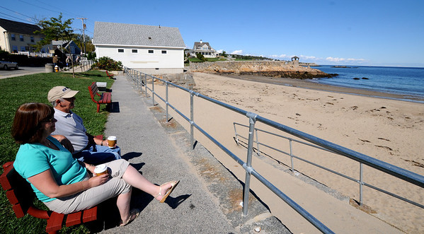 Jim Vaiknoras/Gloucester Daily Times: <br /> John and Maria King relax on one of the benches on Front Beach in Rockport Monday. The town plans on replacing the benches, which are in varying degrees of disrepair.