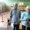 Allegra Boverman/Gloucester Daily Times Manchester residents Domenic and Dorothy Maio cast their ballots during the Massachusetts State Primary on Thursday morning at Memorial Elementary School in Manchester.
