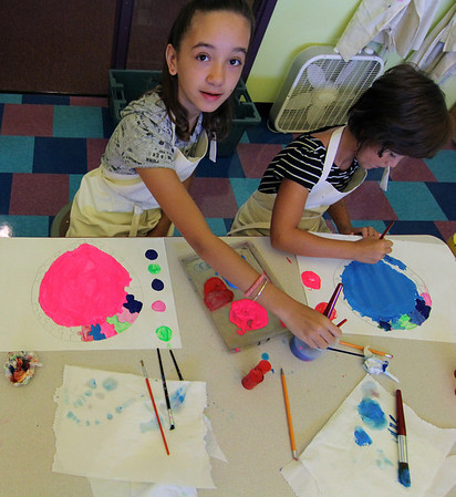 """AAllegra Boverman/Gloucester Daily Times. Students at Gloucester Community Arts Charter School are commemorating International Dot Day which is Saturday, by doing mixed media artworks of dots, to """"make their mark.""""  Children, teachers, and librarians around the country and world will celebrate creativity and honor Dedham-based author and illustrator Peter H. Reynolds's book """"The Dot.""""<br /> The celebration, known as """"International Dot Day,"""" began five years ago in an Iowa classroom when a teacher and his students celebrated the """"birthday"""" of the book, originally published on Sept. 15, 2003, a news release about the event said. It grew from there to include students and teachers in all 50 states and on six continents.  The book shares the story of a girl named Vashti, who begins a journey of self-discovery after she is dared by her teacher to """"make her mark."""" Capturing the power of the caring teacher, The Dot demonstrates how someone who encourages students to explore their unique gifts can impact their entire lives.  Amarrah Woo, left, and Luciana LoCoco, fourth graders, work on their dot art on Thursday morning."""